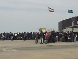A crowd of passengers are seen at the Bileh Savar border crossing in Ardebil province, northwest Iran.