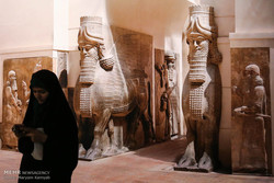 A woman visits the Louvre show at the National Museum of Iran in downtown Tehran.