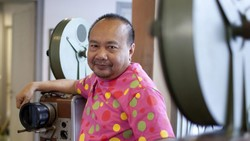 Cambodian director Rithy Panh poses at the Bophana Center, a non-governmental organization, founded by Panh, that collects image and sound archives related to Cambodia. (AP Photo/Vann Channarong)