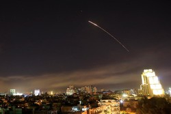 Damascus skies erupt with missile fire as the U.S. launches an attack on Syria targeting different parts of the capital Syria, early Saturday, April 14, 2018. Syria's capital has been rocked by loud explosions that lit up the sky with heavy smoke as U.S. President Donald Trump announced airstrikes in retaliation for the country's alleged use of chemical weapons. (AP Photo/Hassan Ammar)