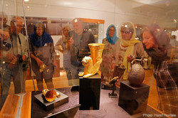Foreign travelers look at historical relics on show at the National Museum of Iran, downtown Tehran.