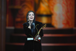 "Mina Sadati holds the Tiantan for best supporting actress she received for her role in Iranian drama ""Searing Summer"" at the Beijing International Film Festival in China on April 22, 2018. (BJIFF)"
