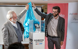 The Managing Director of the Book City Institute Mehdi Firuzan (L) and Fidibo CEO Majid Qasemi unveil the first Persian e-book reader during a ceremony on April 28 in Tehran