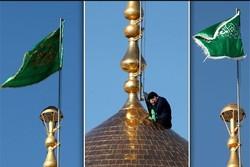 پرچم حرم حضرت معصومه (س) در جوار قبر شهید «نادر مهدوی» برافراشته شد