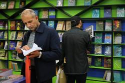Two men visit the 31st Tehran International Book Fair at Imam Khomeini Mosalla on May 7, 2018. (Mehr/Maryam Kamyab)