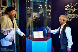 Cultural activist Ahmad Mohit-Tabatabai (L) and filmmaker Mohammadreza Aslani unveil Iran's oldest film document ever found at the Film Museum of Iran on May 9, 2018. (Mehr/Behnam Tofiqi)
