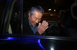 Japanese musician Kitaro acknowledges the people welcoming him at the Imam Khomeini Airport near Tehran on October 13, 2014.