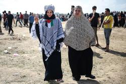 بەشداریی ژنانی فەلەستینی لە خۆپیشاندانی دژە ئیسرائیلی