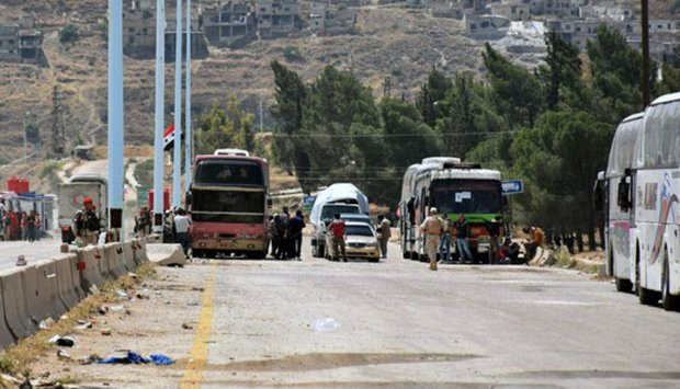 3rd batch of terrorists exit Hama, Homs to northern Syria