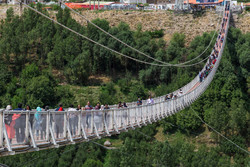 People cross a massive suspension bridge in Meshgin Shahr