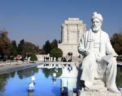 A view of Ferdowsi mausoleum with a statue of the Persian poet in the foreground
