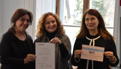 Papillon Association co-founders Sahar Ghaleh Assadi, Soha Khoie and Farzaneh Piranviseh pose after accepting the Prix Salut l'étranger-era in 2016. (RTN)