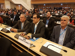 Hassan Qazizadeh Hashemi (C) at 71st World Health Assembly