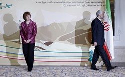 Former EU foreign policy chief Catherine Ashton, left, smiles, as then secretary of Iran's Supreme National Security Council and chief nuclear negotiator Saeed Jalili walks away, after a photo op at the start of high-level talks between world powers and Iranian officials in Almaty, Kazakhstan, on May 29, 2013. (Photo credit: AP/Shamil Zhumatov)