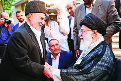 Leader of the Islamic Revolution Ayatollah Seyyed Ali Khamenei shakes hands with poet Hossein Karimi Maraghei during an iftar dinner at his home in Tehran on May 30, 2018. (Leader.ir)