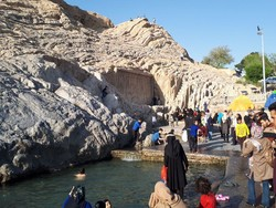 People visit Cheshmeh-Ali, a historical site in southern Tehran.