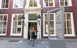 Visitors exit from Pulchri Studio in The Hague, which will host an international painting symposium on June 16.