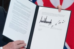 Trump, Kim sign joint document at historic summit
