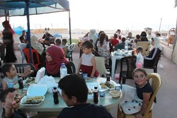 Iran hosts Palestinians for Iftar in Gaza Strip