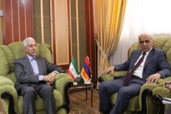 The Iranian science minister Mansour Gholami and the Armenian ambassador to Iran Artashes Toumanian