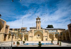 Photo depicts a flock of birds flying over Emad al-Doleh Mosque, a 19th-centry complex in Kermanshah, western Iran, on June 23, 2018.