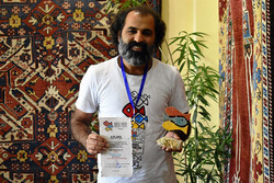 "Iranian director Mir Abbas Khosravinejad poses after accepting the award for best short film for ""Foruzan"" at the Fresco International Festival of Modern Art and Spiritual Films in Yerevan, Armenia on"