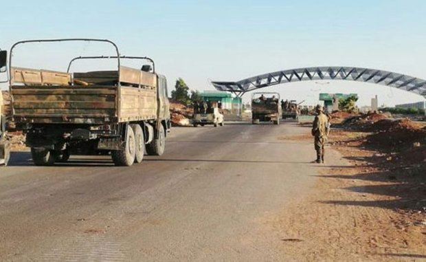 Syrian army hoist flag over Nassib border crossing with Jordan in Daraa