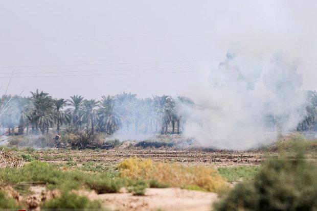 دود آتش سوزی بخش عراقی هورالعظیم در خوزستان/ اعزام بالگرد آب پاش