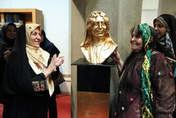 Writer Parichehr Soltani Zarasvand (L) and vocalist Parvin Bahmani pose after unveiling a bust of the Constitutional Revolution activist Bibi Maryam Bakhtiari at the National Library and Archives of I