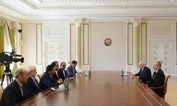 Iranian Health Minister Hassan Qazizadeh-Hashemi (4th L), and Azerbaijan President Ilham Aliyev (1st R)