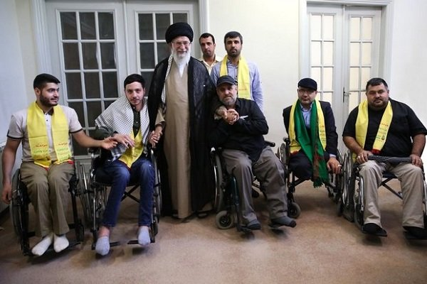 Leader receives Lebanese Hezbollah war veterans, disabled
