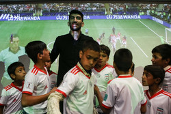 Iran's goalie watches World Cup final with child laborers