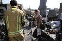 آتش سوزی دریک ساختمان تجاری در چهارراه ولیعصر