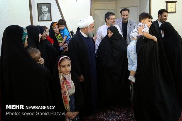 President Rouhani visits a war veteran
