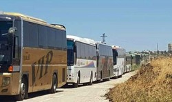 55 buses transporting hundreds of terrorists ,their families leave Quneitra