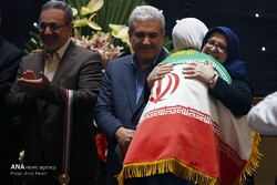 Fatemeh Mohajerani is warmly embracing one of the Iranian medal winners.