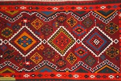 Handmade kilims on display at Carpet Museum of Iran