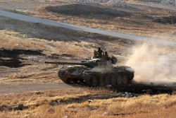 Armed groups in Syria's southwest surrender tanks, howitzers
