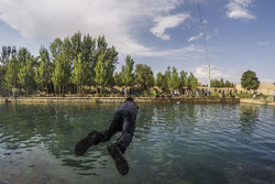 Swimming at Cheshmeh Ali, 'Yaylak of Qajar kings'