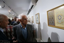 Mohammad Bahrami (R) and his colleagues visit an exhibition of his works at Tehran's Arasbaran Cultural Center on August 9, 2018. (IRNA/Mahtab Beigi)