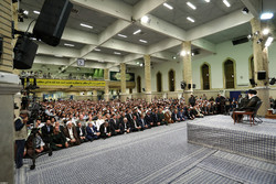 Various groups  of people meet with Leader