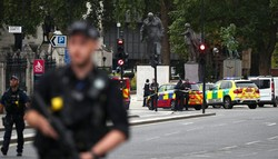 Car smashes into security barriers outside UK parliament, driver detained