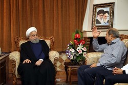 Rouhani visits families of martyrs, war veteran