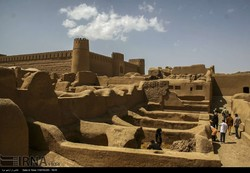 People visit the ruins of Arg-e Rayen, an ancient adobe citadel in Kerman province, southeast Iran.