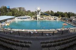 Tehraners enjoy an outdoor swimming pool