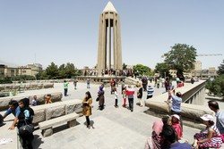 Travelers visit the popular mausoleum of Avicenna in Hamedan, west central Iran.