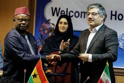ISIRI Deputy Director Moslem Bayat(R) and GSA Deputy Director Charles Amoako shaking hand after signing a co-op document in Tehran on August 25,2018.