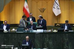 Economy Minister Massoud Karbasian
