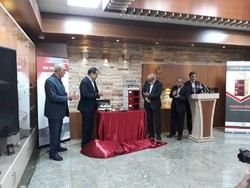Health Minister Hassan Qazizadeh-Hashemi(l) and the company managing director Kourosh Karbasian unveils the first Iranian-made HPLC instrument during a ceremony on Sunday