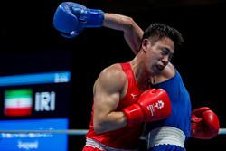 Iranian boxer defeats Japanese rival at 2018 Asia Games